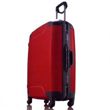 Фото Красный чемодан на колесах 00568